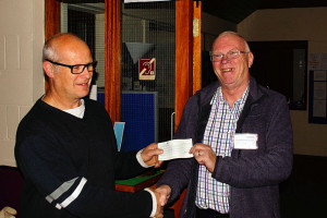 Martin presenting cheque to Mike.